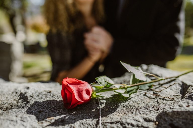 what to do when a loved one dies put a rose on grave